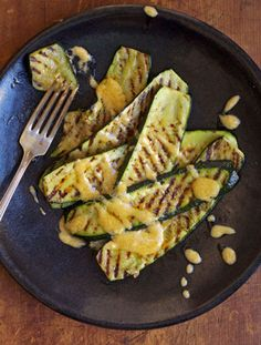 The combination of grilled squash and a cool, creamy aioli flavored with ramps is springtime at its best. Once ramp season has passed, you can substitute scallions in the aioli.