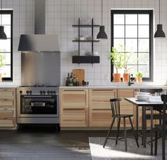 Ikea Torhamn Kitchen - I was thinking of these lowers instead of the glossy flat grey ones.