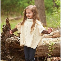 Your little lady will love layering up in this cozy cabled poncho designed by Lorna Miser in Willow Cub yarn.