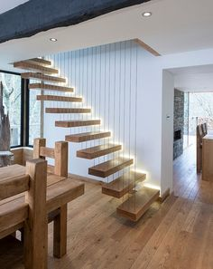 Brilliant staircase with Solid American White Oak steps and steel supporting wires [Design: Heritage Doors and Floors]