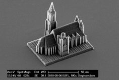 An electron microscope photograph shows a micro-scale model of Vienna's St. Stephans cathedral created by a newly developed printing technique. The base of the model is 100 micrometers inches) long. (Reuters/Vienna University of Technology) Impression 3d, Build A 3d Printer, Liquid Resin, Grain Size, Saint Stephen, Electron Microscope, Famous Buildings, Grain Of Sand, The Design Files
