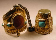 21k gold, applied filigree, thimble and ring (Fig 30), set with turquoise and carnelian stones, and joined by a silver chain.