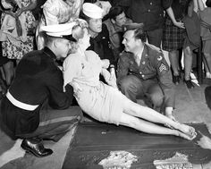 Betty Grable when her legs are recorded in the concrete forecourt of Grauman´s Chinese Theatre. February, 1943