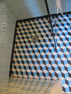 A custom Cubes cement tile bathroom in a New York City apartment. Tile from Villa Lagoon Tile.