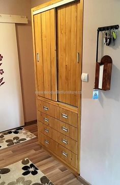 The drawers of the closet appear as they are small in width and there are multiple drawers, but there are 4 total drawers. You can see the drawers when opened, the handles are used silver and they are looking nice on the skin colored closet. Golden can also be selected if the person wants a sober look.