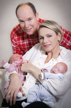 dailymail:  First photos of Monaco's Twins, December 23, 2014-Prince Albert and Princess Charlene holding Princess Gabriella and Prince Jacques, born December 10, 2014