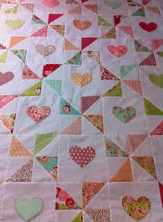 Hearts and pinwheels quilt top. Made with Moda Scrumptious charm pack.