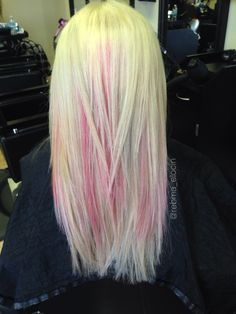 Platinum blonde with pink highlights and soft, blended layers