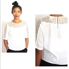 White boxy blouse White boxy blouse with feminine, circle crochet design that extends to sleeves. Back button closure. Chic and versatile. Perfect with your fave jeans, pants or pencil skirt. Marineblu Tops Blouses