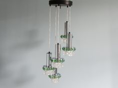 1970S adjustable five-tiered ceiling light made from glass and chrome with feature green detail. In excellent vintage condition and recently rewired and tested. A beautiful light which would look amazing in a living room, hallway or over a dining table.