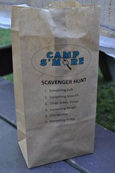camp s'more camping themed birthday party  - print scavenger hunt on lunch bags. Free printables.