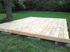 Deck from pallets; everything was saved: pallets, lumber and even nails. This cost me literally 0$. 9 pallets, 1 or 2 more to get some lumber to solidify the deck. I will finish it soon: tint, close all side, remove grass under it and add a table that will most likely be built with some more pallets.