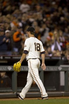 SAN FRANCISCO, CA - JUNE 28: Matt Cain #18 of the San Francisco Giants returns to the dugout after being relieved against the Cincinnati Reds during the eighth inning at AT&T Park on June 28, 2014 in San Francisco, California. (Photo by Jason O. Watson/Getty Images)