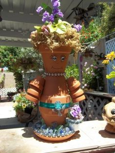 """Clay Pot Gal - part of me thinks it's whimsical but the other part says """"tacky!"""""""