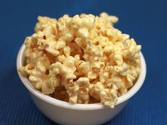"""Marshmallow Popcorn (Think Rice Krispie Treat meets Popcorn!)  I'm dying to try this, and luckily, it's a """"quikie!"""" (muahaha, that was for you, Carol!)  I made them into popcorn balls, for convenient little gifts to neighbors!"""
