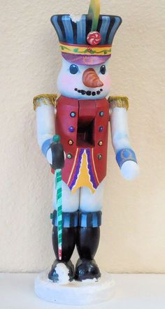 Decorative painting: A Hand Painted wooden tole Snowman Soldier nutcracker for the holidays. Sold. http://www.visualgemsstudio.com