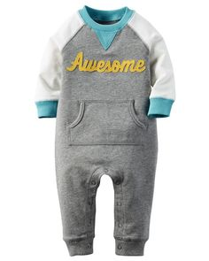 Crafted with raglan sleeves and a fun slogan, this cozy terry jumpsuit is a playtime must have.