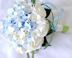 blue hydrangeas and white roses for a wedding bouquet