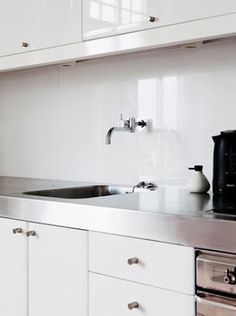 White kitchen, stainless steel countertop
