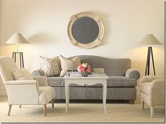 grey sofa, cream armchairs