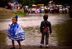 Villamanrique, Spain: Pilgrims cross the Quema river on their way to the shrine of El Rocio   Photograph: Miguel Angel Morenatti/AP