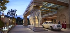 Arrive in style at the grand Porte Cochere of The Leela Palace New Delhi. Statues of two white elephants greets you at the Porte Cochere