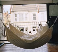 DIY hammock -- white canvas, stainless steel grommets with washers, zinc-plated steel chain and stainless steel s-biners, sewing machine.