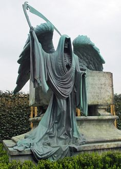 Grimm Reaper Tombstone  (I would love this on my tombstone.  So dramatic, and look at how intricate the ribs and drapery are.)
