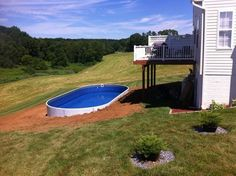 View our above ground pool photos featuring Embassy, Trendium & Radiant pools serving Angola, Fort Wayne & surrounding areas. Sloped Yard, Sloped Backyard, Backyard Pool Landscaping, Backyard Pool Designs, Landscaping Ideas, Backyard Ideas, Backyard Bbq, Semi Inground Pools, Pool Cost