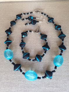 A personal favorite from my Etsy shop https://www.etsy.com/listing/235864336/turquoise-black-rubber-beads-netted