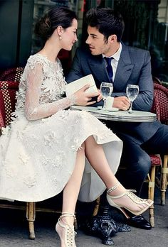 We love this flirty #YolanCris wedding dress, the mesh #ChristianLouboutin wedding booties and the way he's looking at her!