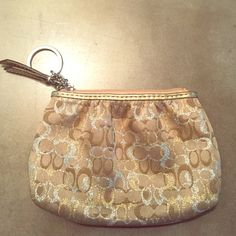 Coach Metallic Coin Purse Authentic Coach mini wallet or coin purse. Signature coach material. Light gold with metallic gold and silver Cs. Lined in light purple. In brand new, unused condition. Was a limited edition print several holiday seasons ago. Coach Bags Mini Bags