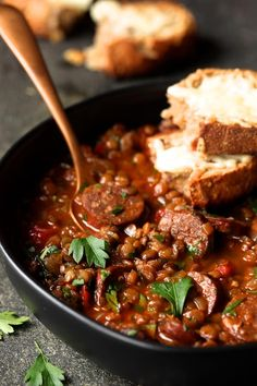Soupy Spanish Lentils with Chorizo and Manchego Toast is the ultimate winter comfort food! Red wine braised lentils, chorizo sausage and cheesy toast! Lentil Recipes, Soup Recipes, Dinner Recipes, Cooking Recipes, Healthy Recipes, Chard Recipes, Cooking Tips, Chorizo Soup, Lentil Stew