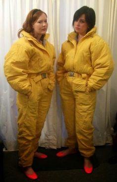 Mandi & Carla in matching yellow onesies .