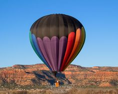 Original hot air balloon art and southwest wall décor, this landscape photography print is available in multiple sizes. Photo title: Jeweled Journey Photographer: Erica Lea This photo was taken at the