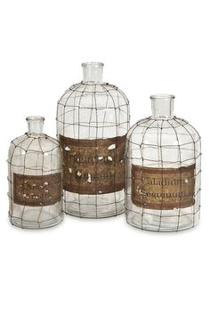 "This set of three wire bottles bring the farm life indoors with the wire aesthetic.  Dimensions:10.5-12-15""h x 5-7-7""d  Dimora Bottle by RENDR. Home & Gifts - Home Decor - Decorative Objects Texas"