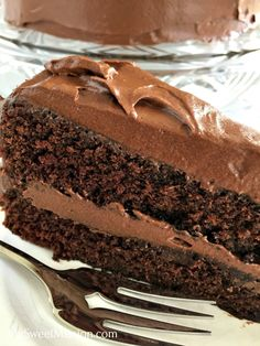 Skip the box and make our Homestyle Chocolate Cake from Scratch. It's super moist, has rich chocolate flavors, and it looks impressive but is easily decorated with a homemade creamy chocolate frosting and a spoon! #chocolatecakes #homestyle #fromscratch #cakes #desserts #frostings
