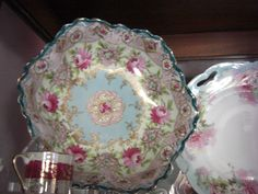 teal scalloped antique bowl with roses
