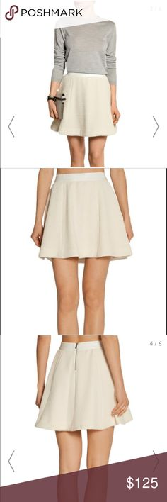 ELIZABETH and JAMES 'Alanis' Skirt Size 8 NWT! Elizabeth and James' 'Alanis' textured stretch-knit skirt has a flattering flared silhouette. This elegant ivory design is fitted with a tonal grosgrain waistband to highlight your waist and is lined in satin for a smooth fit. Style yours with a sweatshirt and heels.   Details:   - Ivory stretch polyester-blend - Zip fastening along back - 72% polyester, 27% viscose, 1% elastane; trim: 54% polyester, 38% viscose, 8% elastane; lining: 97%…