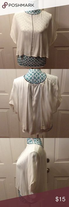 Zara blouse from Europe size XS Zara Cream colored blouse with Black trim brand new with tags never worn. Size XS Zara Tops Blouses