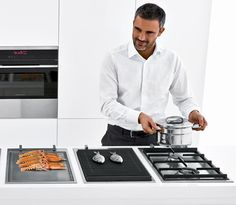 """The collection of modular hobs includes gas, barbecue, teppanyaki and induction units. The 36cm wide modular barbecue comes with electric grilling elements, cast-iron pan support, lava stones for absorption grease and oils, removable drip tray.""    Barazza"