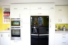 A beautiful White Gloss Curved Kitchen which has been brightened up with sunny yellow walls! Kitchen Cabinets, Kitchen Appliances, Yellow Walls, French Door Refrigerator, French Doors, Beautiful, Home Decor, Diy Kitchen Appliances, Home Appliances
