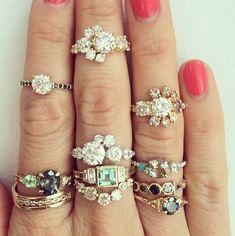 Custom designed white diamond, sapphire, tourmaline, and black diamond rings.