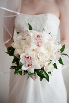 Wedding - White Cymbidium Orchids add just the right contrast.
