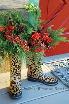 Wellies with Nandina berries, greens & pine cones