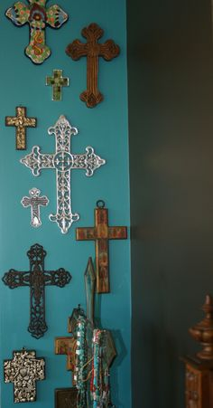 I like the idea of having a wall with different crosses from different places ive traveled or been <3