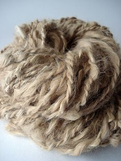Suri alpaca handspun yarn (by Veronika von Allmen)//i think my hair bun could pass for alpaca...Corinne