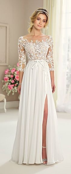 This chiffon, tulle and lace A-line gown features illusion lace 3/4 length sleeves, illusion bateau neckline, illusion lace bodice, and a natural waistband.