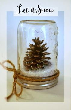 Winter pinecone snow globe craft idea, just glue a pinecone to the lid of your favorite  mason jar, add buffalo snow and done!