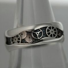 *Available Immediately in size: 9.5*  <br />Steampunk Design with Gears Hand Cut on a Sterling Silver Half Round 8mm wide Band  <br />3.88 dwt <br />***This piece is handmade, each design may vary slightly***